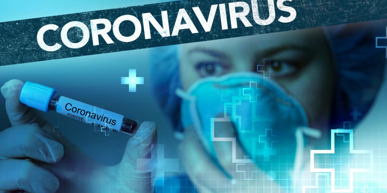 Doctor holds coronavirus positive test tube. (Photo credit: Capitol Broadcasting Company.)